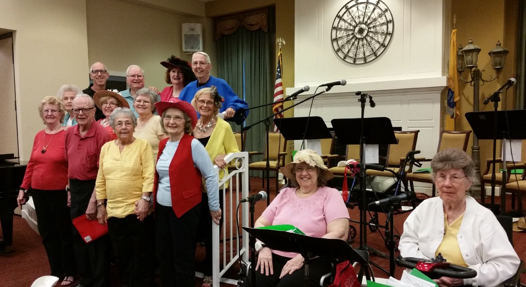 "All 13 ""cast members"" of The Evergreens Acting Studio – Front Row (left to right): Residents Valerie Schwing, Paul Levesque, Louise Phillips, Barbara Farrell, Virginia Passanante, Marie Modic (far right, white jacket); Second Row (left to right): Residents Winnie Holden, Jan Scheckter, Marjorie Minarcik and Alice Gooch (yellow jacket); Third Row (left to right): Robb Hutter, Artistic Director, Philly Senior Stage; Residents Steve Smith, Patricia Rogers and Bill Mulqueen."