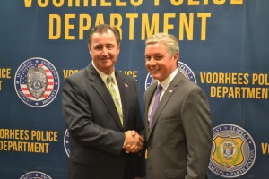 Voorhees Mayor Michael Mignogna, left, shakes hands with Evesham Mayor Randy Brown after announcing the Evesham Saving Lives free designated driver program was expanding to Voorhees.