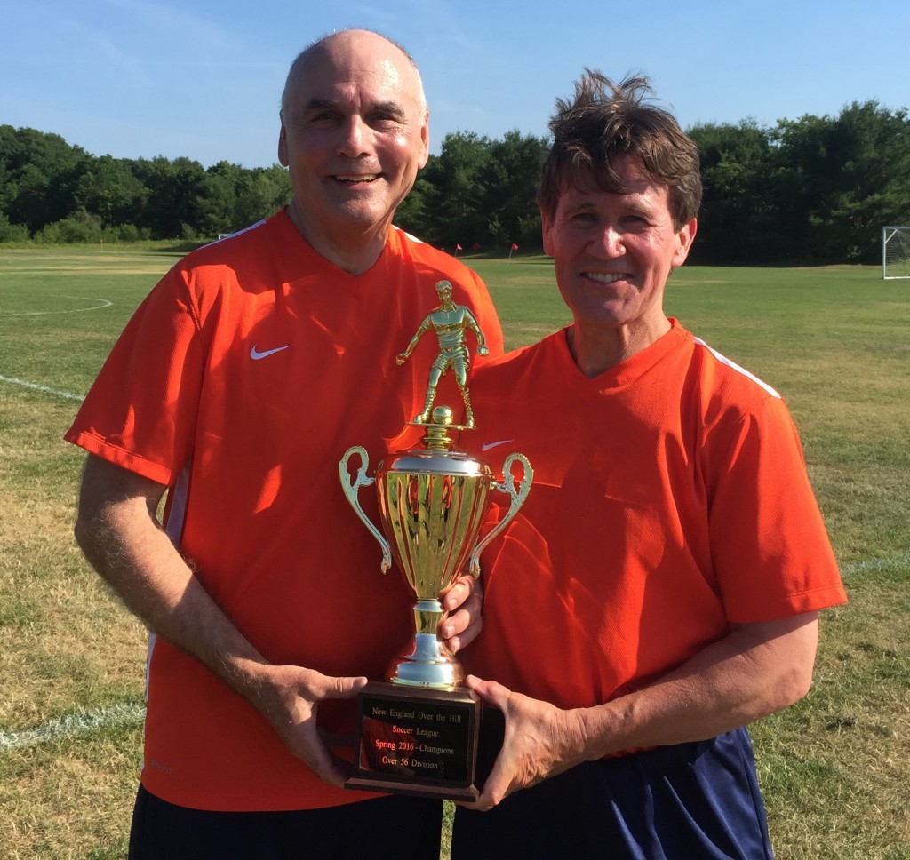 Left to right, Paul Harrison and Brian O'Connor holding the championship trophy for the Over-56 Division of the New England Over the Hill Soccer League tournament. They defeated the Northshore Seadogs, 4-0, in the June 26 final held in Medfield, Mass.