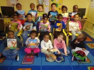 The students in Taisha Sanders preschool class at the Center for Family Services in Winslow Township show their appreciation as they hold books they received for the holidays through the Camden County Library's Books for Kids Holiday Campaign in December 2013. The branches of the Camden County Library systems will be once again hosting the campaign and are accepting new or gently-used books through Dec. 6.